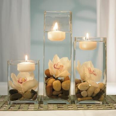 jarrones de cristal piedras decorativas velas agua decoración centro de mesa