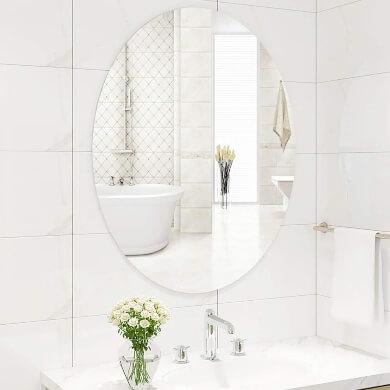 espejo baño pared grande sin marco ovalado diseño moda tendencia